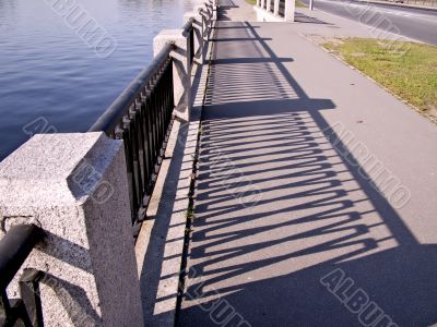Parapet in quay river and shadow parapet.