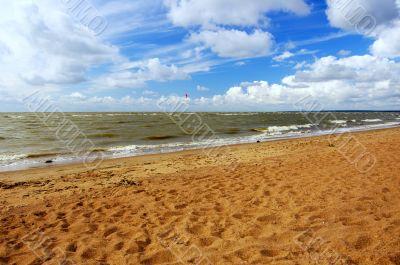 Seashore. Hot sand. Dark blue sky.