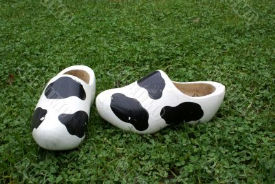 Wooden shoes with cow print.