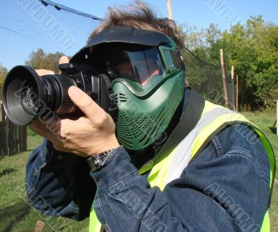 The outdoor photographer with protective mask