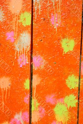 Multicolored blots and stains on wooden surface