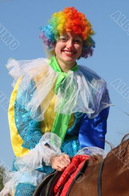 Equestrian clown in colored wig