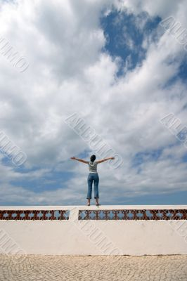 girl with arms wide open