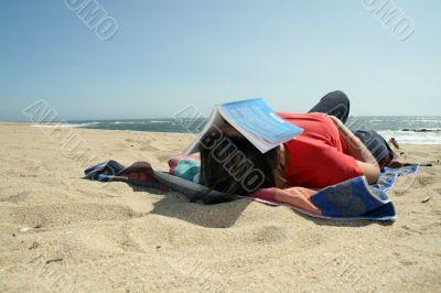 girl sleeping in the beach