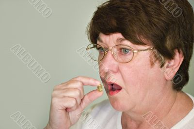 Sick Woman taking a tablet