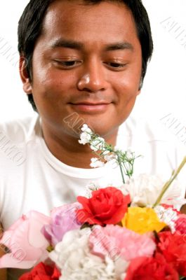 man holds bunch of flowers