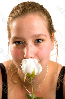 young woman holds a rose