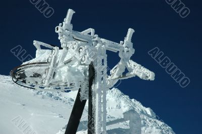 An old ski lift covered with fresh snow