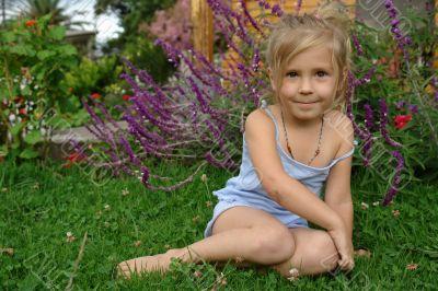 cute little girl on the grass
