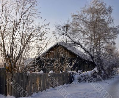 snow-capped log cabin