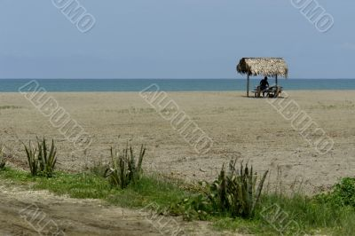 indian woman in a hut on pacific ocean