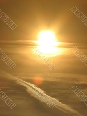 sun, sky and airpalne stripe