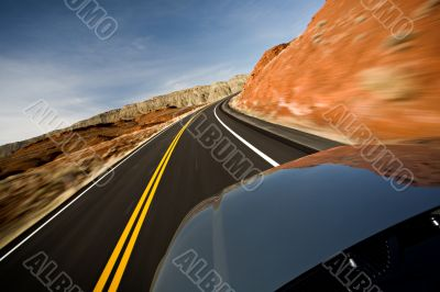 car driving on road with motion blur