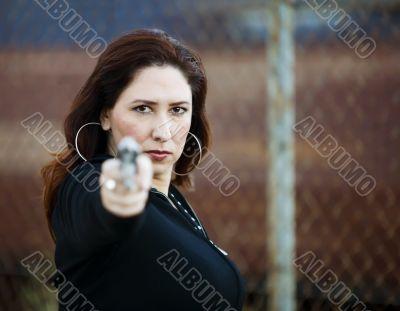 Hispanic Woman with Handgun