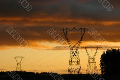Electric towers and dramatic sunset.