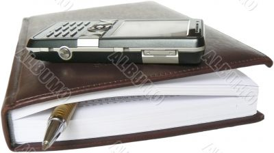 Mobile telephone, note pad and pen