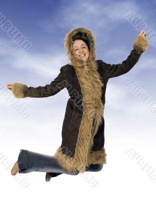 teenager jumping of joy in winter