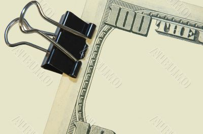 black paper clip and the US dollars