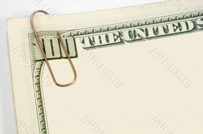 red paper clip and the US dollars