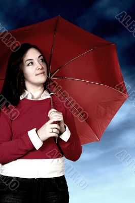girl with umbrella in a bad weather day