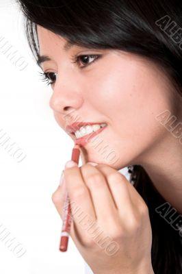 beautiful girl applying make up