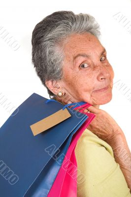 beautiful elderly woman with shopping bags