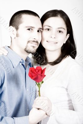 casual couple in love - red flower