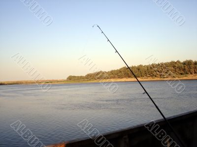 Landscape with fishing rod
