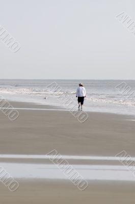 Woman Walking on Beach-Vertical