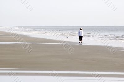 Woman Walking on Beach - Horizontal