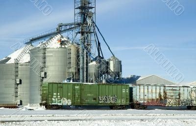 Grain Storage and Rail Cars with Graffiti