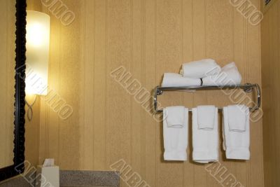 Light, tissue box and towels