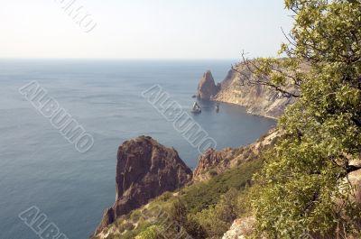 sea, yacht and rocks