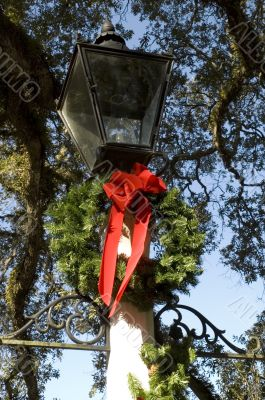 Decorative Lamp Detail with Christmas Wreath and Red Bow