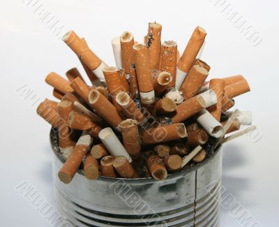 Pile of cigarette butts in ashtray