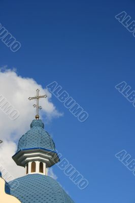 Blue cloudy sky with with blue church cupola