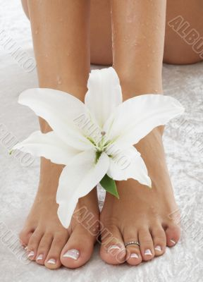 feet with white lily