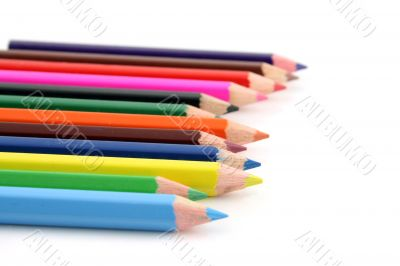 Colored pencils on a white background with a shallow DOF