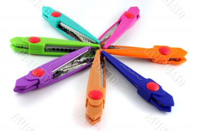 Brightly colors craft scissors on a white background