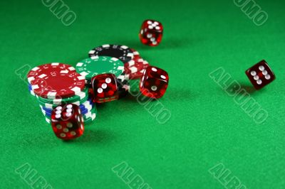 An Action shot of 5 dice thrown onto the table