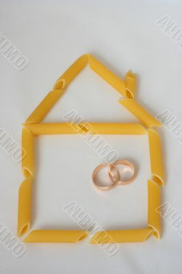 Home contour made from pasta with two wedding rings