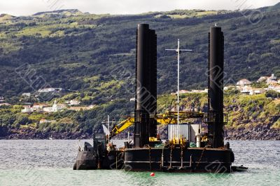 Dredger and barge