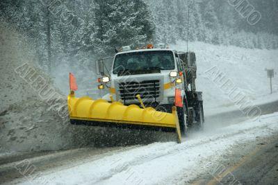 Snowplow clearing road