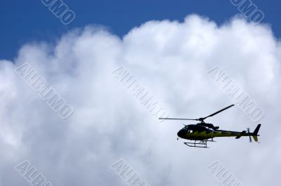 Helicopter silhouette in a cloud
