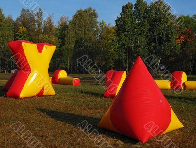 paintball battlefield, inflatable figures on field