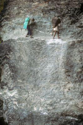 Porters on steep trail