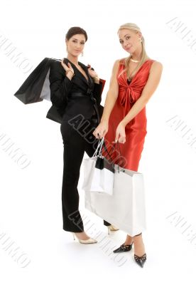 two happy girls with shopping bags