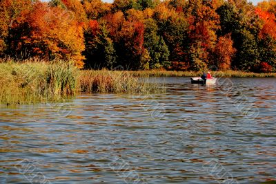 couple fishing with fall colors