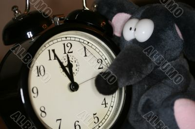toy mouse and clock in eve of new year