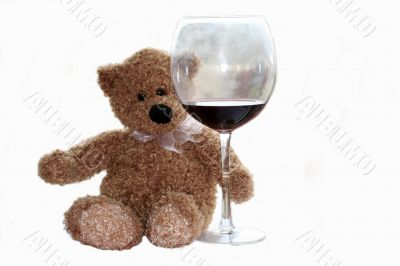teddy bear with glass of wine isolaited on white background